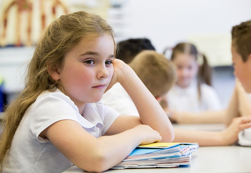 School-aged girl sitting at desk with files for family law matter