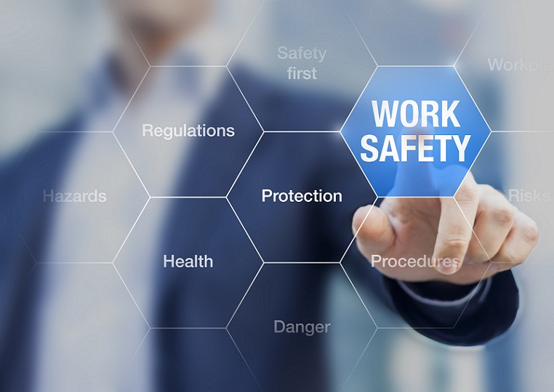 Directors duties and workplace safety concept, with hand pointing to graphic of work safety
